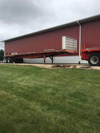 Semi flatbed trailers set up for Concrete pipe w/unloaders (Marengo) $10000
